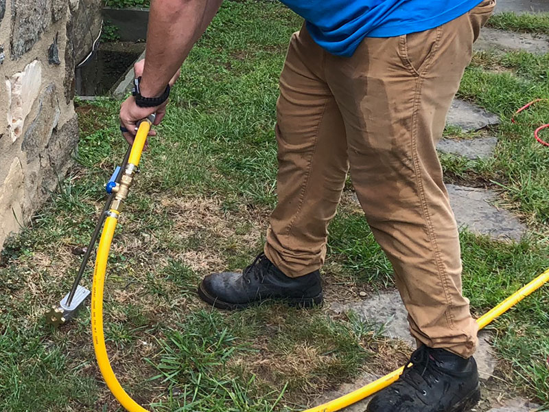 Our technician uses a rod to inject termiticide into the soil and concrete to create a barrier between the home and property.